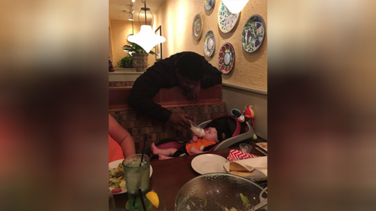 Olive Garden server feeds baby for exhausted mom