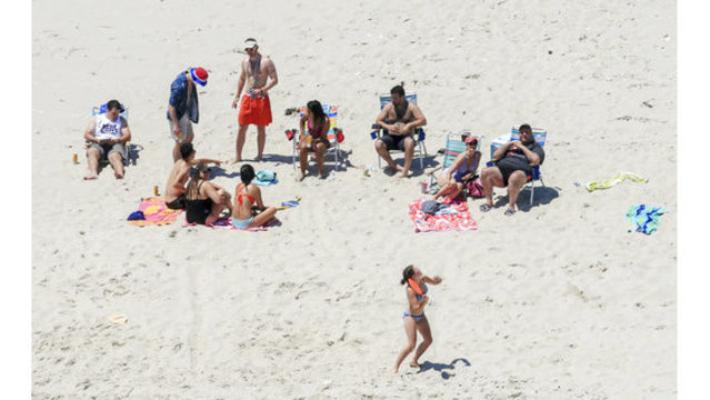 Christie lounges with family on beach at park he shut down