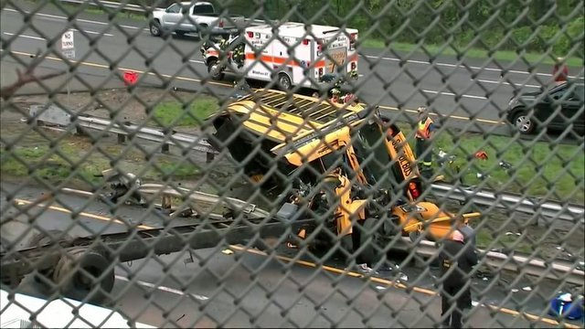 New Jersey school bus collides with truck, killing teacher and student