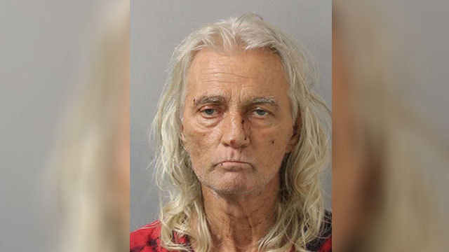 Man arrested after walking down the street with stolen AR-15