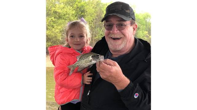 5-19 Chuck Parrish with 2 year old Grandaughter_1558156991065.jpg.jpg